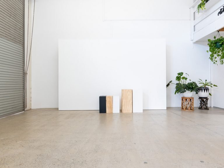 white gallery wall with apple boxes